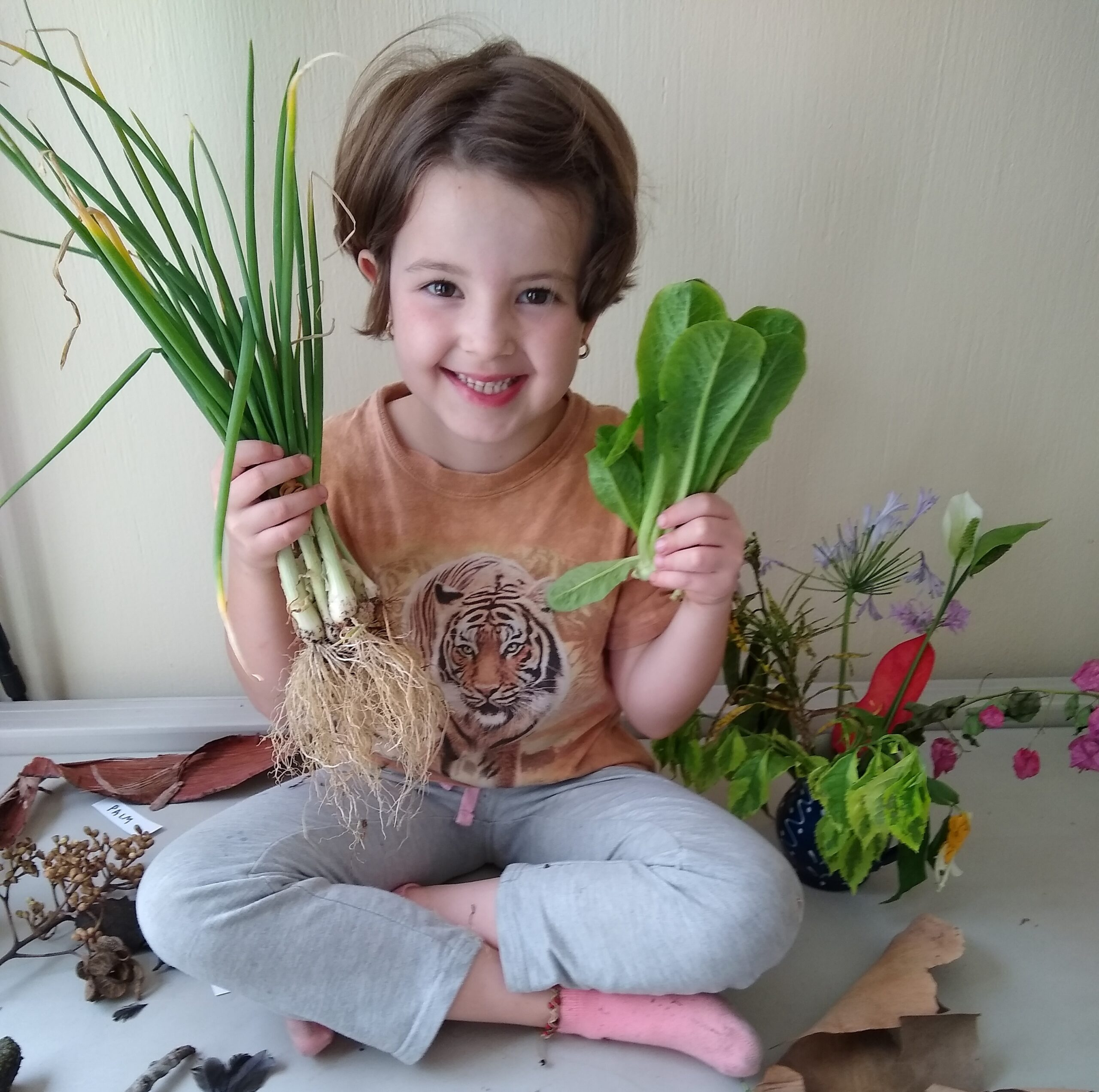 Young Girl with Harvested Vegetables from the Vegtable Garden